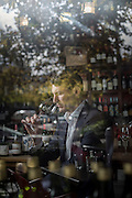 John Eales former Australian Rugby Union captain testing wine at in the Bottle shop of Delicado Foods Spainish resturant McMahons Point Sydney.