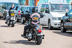 "© Licensed to London News Pictures. 01/06/2019. Brighton, UK. Members of the Notorious bikers club, the Hells Angels ride from London to Brighton as part of the 2019 Euro Run and the 50th anniversary of the UK ""chapter"". Photo credit: Hugo Michiels/LNP"