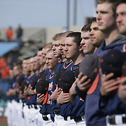 Members of The University of Virginia Baseball team observe the National Anthem before their season opener against The University of Kentucky.The university of Kentucky faced the University of Virginia in the opening game of the Hughes Brothers Challenge Friday February 14, 2014 at Brooks Field on the campus of the University of North Carolina at Wilmington in Wilmington, N.C. (Jason A. Frizzelle)