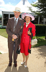 The HON.SIR DAVID & LADY SIEFF at the 4th day of the 2005 Glorious Goodwood horseracing festival at Goodwood Racecourse, West Sussex on 29th July 2005.    <br />