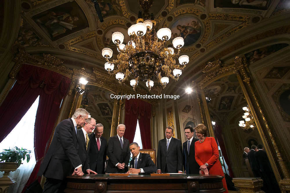 U.S. President Barack Obama signs the first executive orders of his second administration in the presence of congressional leadership directly after swearing-in ceremonies in the U.S Capitol in Washington, January 21, 2013.