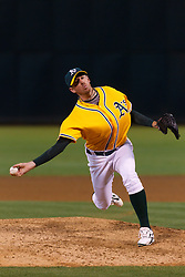June 29, 2011; Oakland, CA, USA; Oakland Athletics relief pitcher Brad Ziegler (31) pitches against the Florida Marlins during the ninth inning at the O.co Coliseum.  Florida defeated Oakland 3-0.