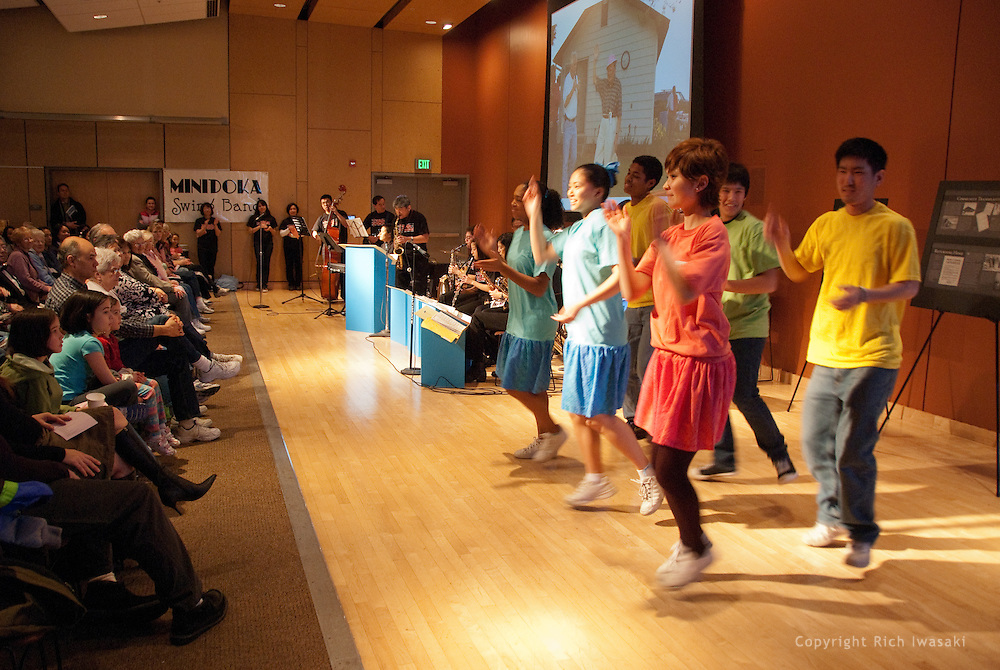 Members of Unite People youth group dance to the music of the Minidoka Swing Band in the Community Room at Tigard Library, Tigard, Oregon. The performance was part of the kick-off event for Oregon Reads 2009 state-wide program.