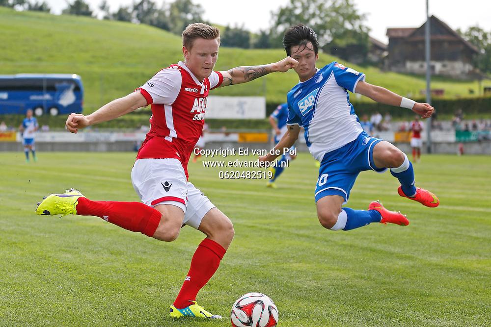 WEGGIS - 31-07-2014 - Hoffenheim - AZ,  Thermoplan Arena, oefenwedstrijd, AZ speler Mattias Johansson (l), Kim Jin-Su (r).