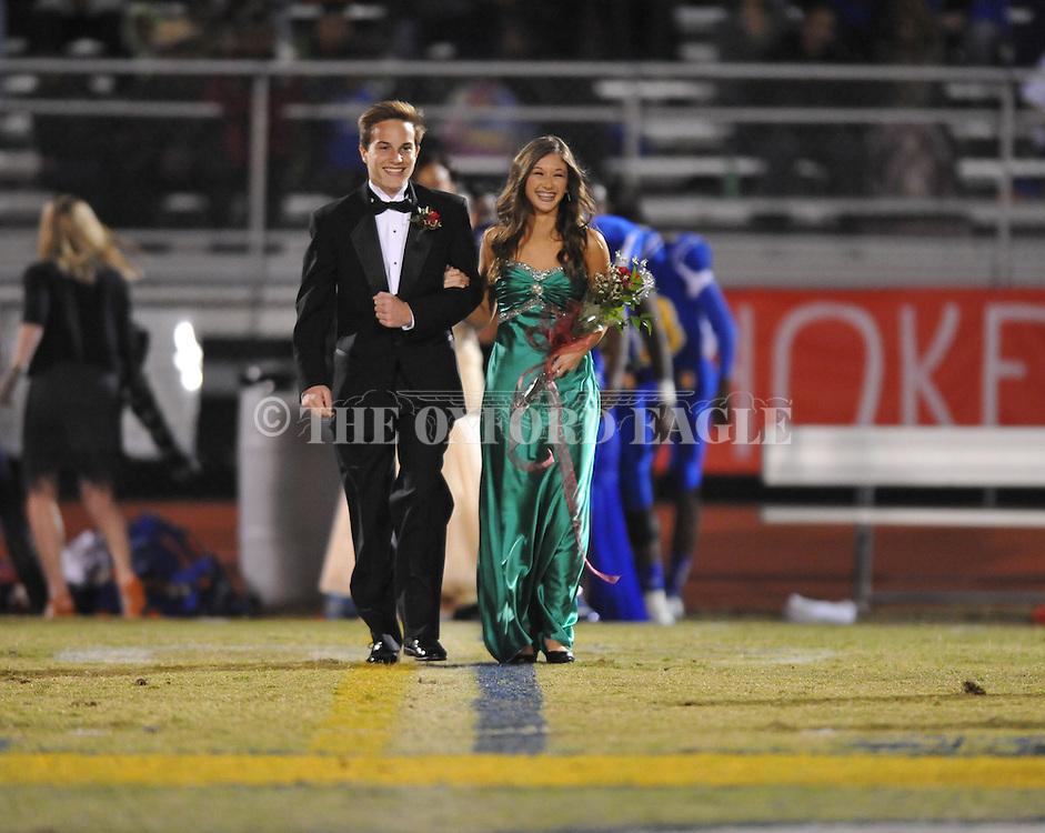 Luke Toler (left) escorts freshman maid Ivy Abel during Homecoming ceremonies vs. Saltillo in Oxford, Miss. on Friday, October 19, 2012. Oxford won to improve to 9-0.