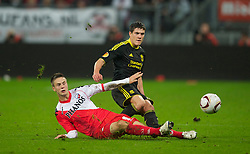 UTRECHT, THE NETHERLANDS - Thursday, September 30, 2010: Liverpool's Martin Kelly and FC Utrecht's Ricky van Wolfswinkel during the UEFA Europa League Group K match at the Stadion Galgenwaard. (Photo by David Rawcliffe/Propaganda)