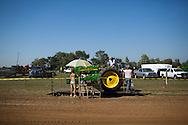 Larry Richards weighs his tractor during a tractor pull in Girard, Kansas, Sep. 6, 2010.