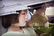 Fukuyu,geisha and Fukukimi,'maiko' (geisha apprentice)in taxi going to work.Geisha's distric of Miyagawacho.Kyoto. Kansai, Japan.