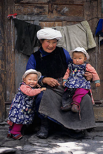 China, People, Tibetan farmers, Grandma holding twin grand- Children Sichuan, China.