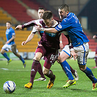 St Johnstone v Hearts.....18.01.14   SPFL<br /> Brad McKay blocks Tam Scobbie's run at goal<br /> Picture by Graeme Hart.<br /> Copyright Perthshire Picture Agency<br /> Tel: 01738 623350  Mobile: 07990 594431