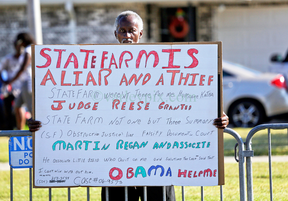 27 August 2015. Andrew P. Sanchez & Copelin-Byrd Multi Service Center, Lower 9th Ward, New Orleans, Louisiana.<br /> A Lower 9th Ward resident protests his treatment by insurance giant State Farm and begs President Barack Obama for help.<br /> Photo credit©; Charlie Varley/varleypix.com.