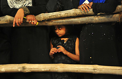 October 28, 2016 - Allahabad, Uttar Pradesh, India - Allahabad: A child Shia Muslim watch the mourning procession during Muharram in Allahabad on 28-10-2016, Muharram is celebrated to mark the climax of the mourning which is Called Ashura, The ccommenmoration of Imam Hussain's. photo by prabhat kumar verma (Credit Image: © Prabhat Kumar Verma via ZUMA Wire)