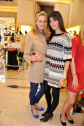 Left to right, BODIL BLAIN and LISA BILTON at a fun filled tea party hosted by Roger Vivier to view their Jeune Fille collection of shoes in aid of Mothers4Children held at Roger Vivier, Sloane Street, London on 27th March 2012.