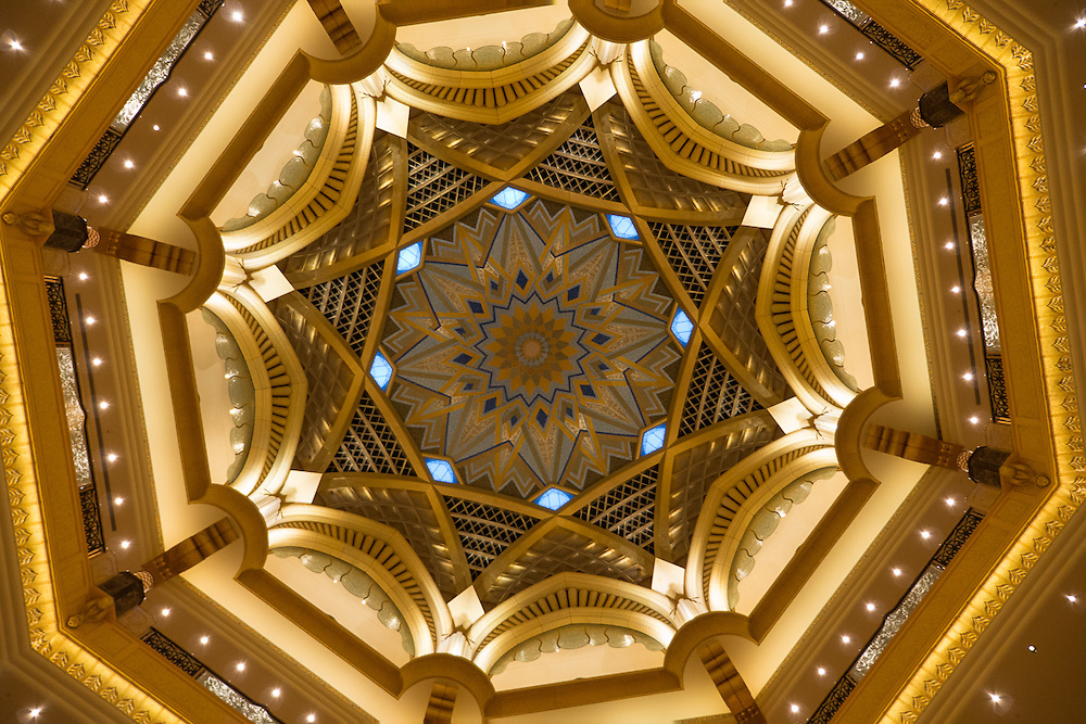 The Emirates Palace is a seven star luxury hotel in Abu Dhabi, United Arab Emirates. Designed by architect, John Elliott RIBA,the hotel was built by and is owned by the Abu Dhabi government, .The costs to build the hotel were 3.9 billion GBP or 11.02 billion AED. The Emirates Palace occupies 850,000m² of floor space. Underground parking allows housing for 2,500 vehicles. There are two swimming pools and spas. The hotel has its own marina and helipad. The Emirates Palace is the second most expensive hotel ever built, only surpassed by Marina Bay Sands in Singapore.