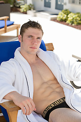handsome man relaxing in outdoors in an open robe