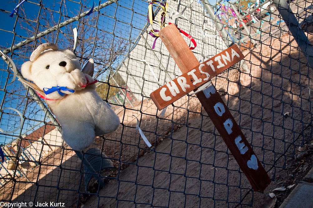 tucsonshooting - 10 JANUARY 2011 - ORO VALLEY, AZ: A teddy bear and a cross at a memorial at Mesa Verde Elementary School in Oro Valley. Christina Green was a student at the school.  ARIZONA REPUBLIC PHOTO BY JACK KURTZ...Gabrielle Giffords shooting