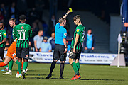 Coventry City midfielder Tom Bayliss (20) receives a yellow card during the EFL Sky Bet League 1 match between Luton Town and Coventry City at Kenilworth Road, Luton, England on 24 February 2019.