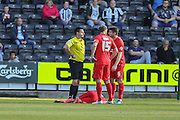 York City midfielder Luke Summerfield lies down injured  during the Sky Bet League 2 match between Notts County and York City at Meadow Lane, Nottingham, England on 26 September 2015. Photo by Simon Davies.