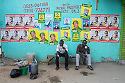 Dar es Salaam, Tanzania - 10/25/15 - Men take a tea break under election posters around the corner from a polling station in Dar es Salaam, Tanzania on October 25. Photo by Daniel Hayduk