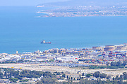 Israel, Haifa, a view of downtown and the bay from the Carmel Mountain. The city of Acre can be seen in the background