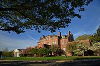 Spring morning sun illuminates Holladay Hall.