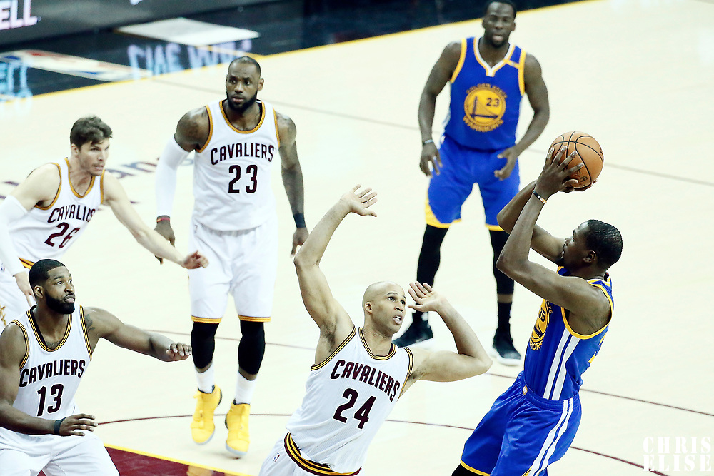 09 June 2017: Golden State Warriors forward Kevin Durant (35) takes a jump shot over Cleveland Cavaliers forward Richard Jefferson (24) during the Cleveland Cavaliers 137-11 victory over the Golden State Warriors, in game 4 of the 2017 NBA Finals, at  the Quicken Loans Arena, Cleveland, Ohio, USA.