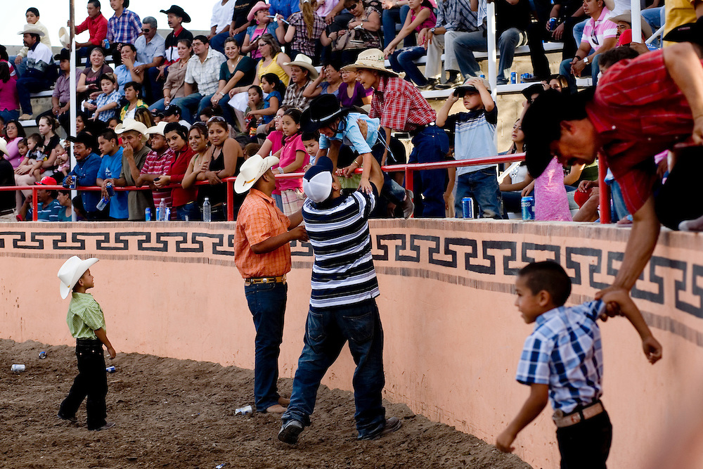 Julia Robinson photo.During a break in the action, children are lowered into the arena for a goat chase.