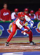 MEXICO CITY - MARCH 10: Second baseman Hector Olivera #28 of Cuba bunts for an out while advancing a baserunner to second base during the Pool B, game four against Australia in the first round of the 2009 World Baseball Classic at Foro Sol Stadium in Mexico City, Mexico, Tuesday March 10, 2009. Cuba defeated Australia 5-4. (Photo by Paul Spinelli/WBCI/MLB Photos) *** Local Caption *** Hector Olivera