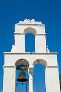 The white washed belltower of Agios Dimitrios against a clear blue sky.<br /> Paxos, Ionian Islands, Greece