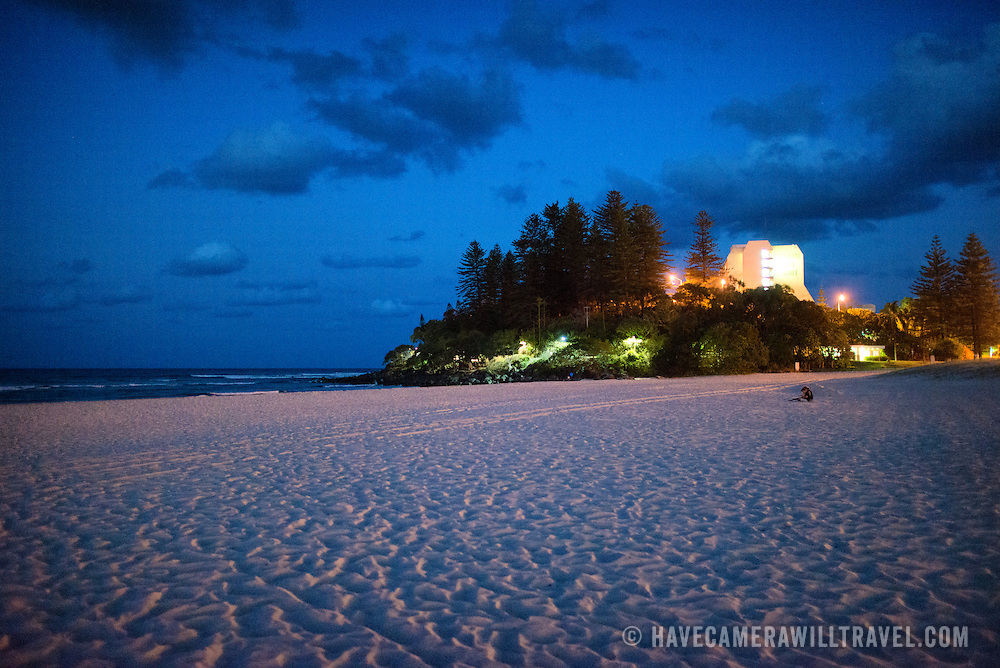 "Looking towards Pat Fagan Park on the headland at Coolangatta at dusk. Sometimes paired as ""Twin Towns,"" Coolangatta and Tweed Heads, on the southern end of the Gold Coast, straddle the Queensland-New South Wales border."