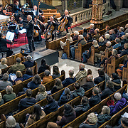 Bach Ouverture No.3 in D major, BMV 1068 <br /> <br /> The newly created Orchestra of St. Veronica, the third concert toke place on February 10th 2018.<br /> <br /> Michael Feldman is conducting an eclectic mix of professional musicians, some of which were founding members of the renowned Orchestra of St. Luke's back in the 1970's. These veterans of the classical repertoire will be joined by younger musicians, whose vigor and brash boldness will offer a striking counterpoint to the former's refined sensibilities. The February 10th concert will fearture a program of compositions by Bach and Mozart.<br /> <br /> After the Church of St. Veronica closed its doors in July of 2017, George Capsis (publisher of WestView News- &quot;The Voice of the West Village&quot;) thought it a shame that a 127 year old tradition of serving the community would be lost. Troubled too by the underserved population of senior citizens in the neighborhood, Capsis was inspired to create a classical concert series that &quot;will always be free to seniors&quot;<br /> <br /> The At St. Veronica's concert series is a grassroots project that depends on public support. The Catholic Archdiocese of New York has granted permission for a trial run of 6 months; by February 10th, this period will be more than half done. These concerts are an expensive undertaking as the value of world-class musicianship comes at a cost. This is YOUR concert hall. If you have any ideas on how St. Veronica's can become a permanent concert hall, please contact: info@AtStVeronicas.org