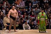 Kakuryu (left) faces Takayasu (unseen) in the Osaka Spring Grand Sumo Tournament in the Osaka Prefectural Gymnasium.