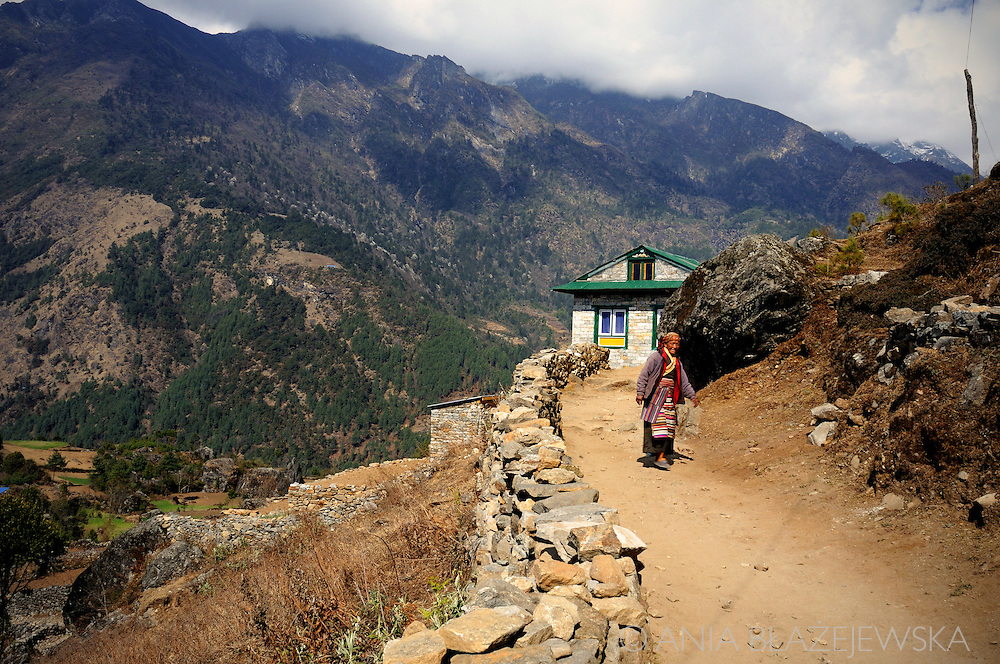 Nepal, Himalayas. Woman on the road in the Everest region.
