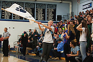 A MMU fans runs down the court with a flag during the first round of the boys high school basketball playoffs between the Colchester Lakers and the Mount Mansfield Cougars at MMU High School on Tuesday night February 16, 2016 in Jericho. (BRIAN JENKINS/for the FREE PRESS)