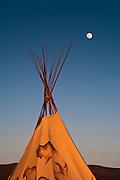 Moonrise over a TeePee near Taos, New Mexico.