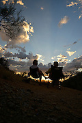 Visitors to Gates Pass wait for sunset in the Sonoran Desert, Tucson, Arizona, USA.