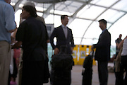 out of focus view of business men and woman waiting to check in at an airport