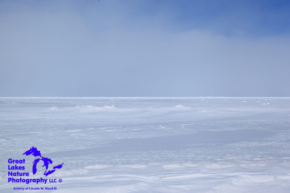 In an image so reminiscent of sea ice photos taken from Alaskan shores, you can see the amazing extent of Lake Superior's freeze-up in the winter of 2013-14. The ice extends from the shoreline at Eagle River to the horizon. As I write this caption, I have just heard of the woes of the fleet of Coast Guard icebreakers that have been struggling to break this ice up for the start of the 2014 Great Lakes shipping season.