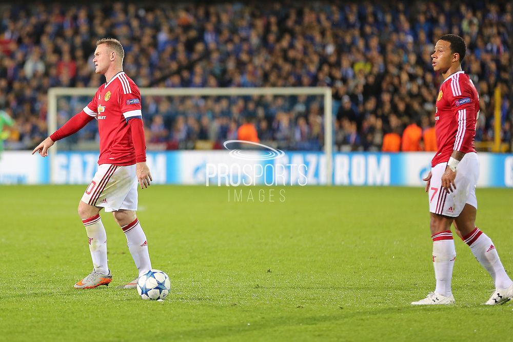 Memphis Depay of Manchester United lines up a free kick with Wayne Rooney of Manchester United looking on during the Champions League Qualifying Play-Off Round match between Club Brugge and Manchester United at the Jan Breydel Stadion, Brugge, Belguim on 26 August 2015. Photo by Phil Duncan.