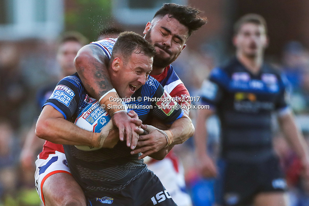 Picture by Alex Whitehead/SWpix.com - 10/08/2017 - Rugby League - Betfred Super League - Wakefield Trinity v Leeds Rhinos - Beaumont Legal Stadium, Wakefield, England - Leeds' Danny McGuire is tackled by Wakefield's David Fifita.