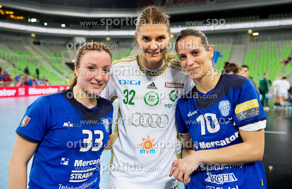 Katarina Krpez #33 of RK Krim Mercator and Andjela Bulatovic #10 of RK Krim Mercator with Katarina Bulatovic of Gyori after the handball match between RK Krim Mercator (SLO) and Gyori Audi ETO KC (HUN) in 4th Round of Main Round of  Women's EHF Champions League 2013/14 on March 1, 2014 in Arena Stozice, Ljubljana, Slovenia. Photo by Vid Ponikvar / Sportida