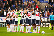 Bolton Wanderers holding a minute of respect before the EFL Sky Bet League 1 match between Bolton Wanderers and Fleetwood Town at the University of  Bolton Stadium, Bolton, England on 2 November 2019.