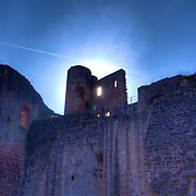 The setting sun glows behind the wall in the view from the Hardenburg castle (circa 1214) courtyard looking west up towards the forecourt area