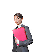 Young businesswoman with pink file against white background