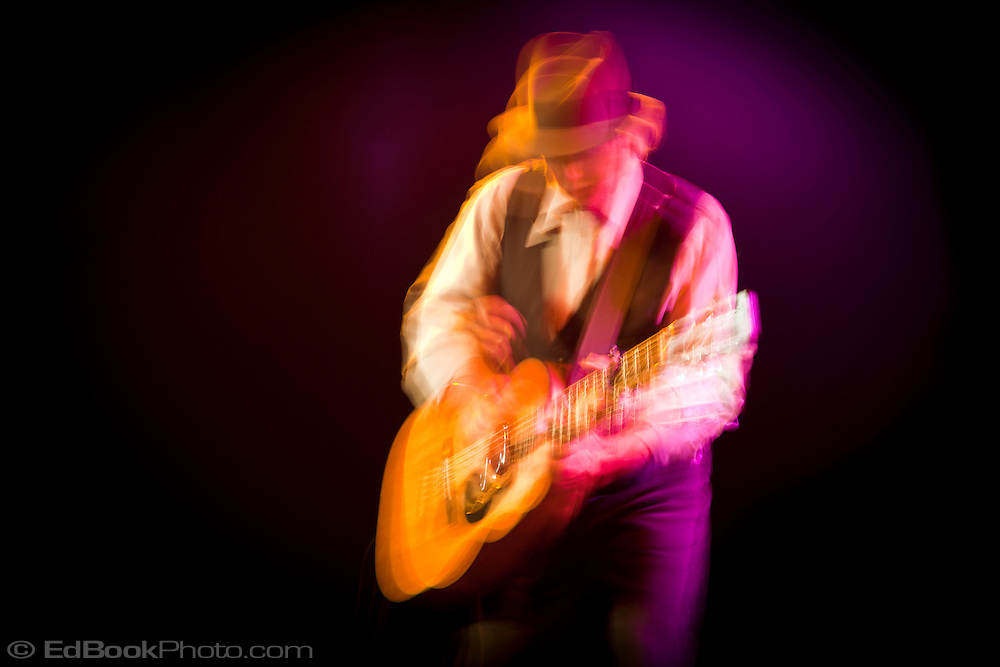 Roy Rogers and the Delta Rhythm Kings playing guitar in a blur