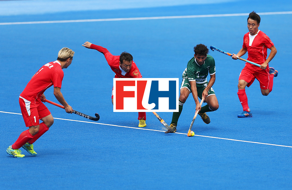 LONDON, ENGLAND - JUNE 25: Muhammad Umar Bhutta of Pakistan and Weibao Ao of China battle for possession during the 7th/8th place match between Pakistan and China on day nine of the Hero Hockey World League Semi-Final at Lee Valley Hockey and Tennis Centre on June 25, 2017 in London, England.  (Photo by Steve Bardens/Getty Images)