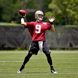 May 28, 2015; New Orleans, LA, USA; New Orleans Saints quarterback Drew Brees (9) throws a pass during organized team activities at the New Orleans Saints Training Facility. Mandatory Credit: Derick E. Hingle-USA TODAY Sports
