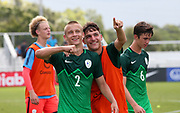 Slovenia defender Jemej Belinc (2) and  midfielder Nik Smec (6) happily celebrate their win over Canada during a CONCACAF boys under-15 championship soccer game, Saturday, August 10, 2019, in Bradenton, Fla. Slovenia defeated Canada in 2-1 in overtime and advanced to the finals against Portugal. (Kim Hukari/Image of Sport)