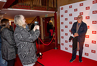 "Members of the audience take photos on the BBC background after the special screening of BBC drama Shakespeare & Hathaway – Private Investigators, is due to hit TV screens late February, 150 lucky people got the chance to view a private screening of the first episode.<br /> On Friday 9 February, The Other Place in Stratford-upon-Avon, an actual location featured in the drama, the venue to held the screening and, a special question and answer session hosted by Midlands Today presenter Rebecca Wood. She was joined by Jo Joyner, Mark Benton, Patrick Walshe McBride and the show's producer Ella Kelly.<br /> The ten-part drama from BBC Studios, created by Paul Matthew Thompson and Jude Tindall, will see Frank Hathaway (Benton), a hardboiled private investigator, and his rookie sidekick Luella Shakespeare (Joyner), form the unlikeliest of partnerships as they investigate the secrets of rural Warwickshire's residents.<br /> Beneath the picturesque charm lies a hotbed of mystery and intrigue: extramarital affairs, celebrity stalkers, missing police informants, care home saboteurs, rural rednecks and murderous magicians. They disagree on almost everything, yet somehow, together, they make a surprisingly effective team – although they would never admit it.<br /> Will Trotter, head of BBC Daytime Drama at the BBC Drama Village, comments, ""For years we have been producing quality drama at the BBC Drama Village, and Shakespeare & Hathaway is no different. It's the perfect programme to indulge in, and like many of the programmes that we make in Birmingham, we've been out and about in the county to film in some of the best locations the Midlands has to offer. <br /> ""We're looking forward to seeing the audience reactions to the first episode, it's got a whodunit storyline with a brilliant introduction to the main characters, but leaves you with some questions which makes the audience want to come back for more!"" <br /> Notes to editors<br /> For more information on the series you can contact hollie.dr"