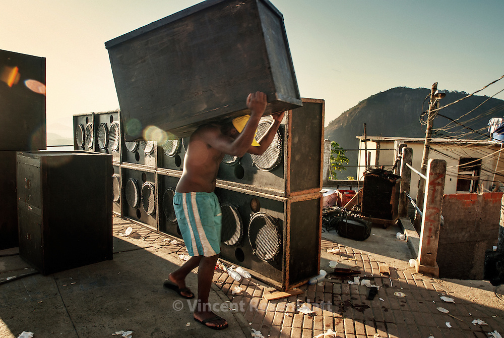 "7 in the morning. Dismounting the soudsystem Pitbull - Boladinho after the ""baile"" which gathered at least 500 dancers on the top of the favela Morro dos Prazeres..The speaker boxes will be transported by men through the narrow lanes of the slum down to the entrance of the favela, only access point for the transport trucks. Santa Teresa, Rio de Janeiro 2007.     